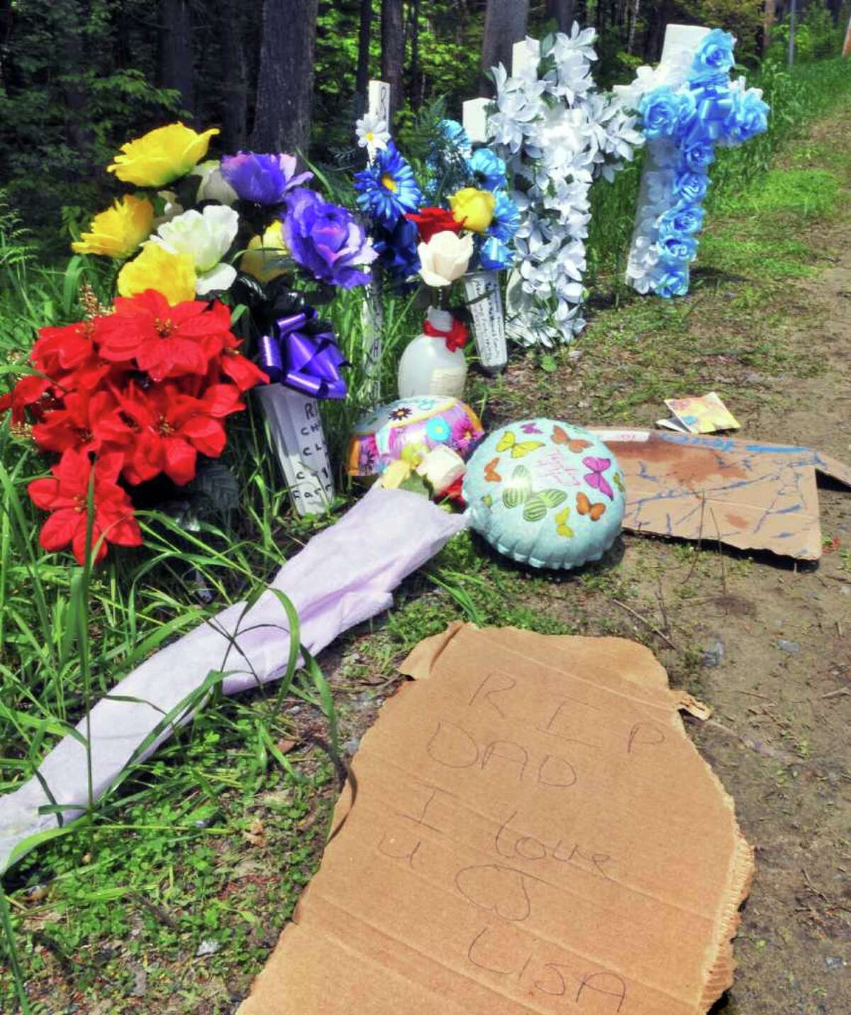 A roadside memorial Tuesday afternoon, May 24, 2011, marks the scene where Chad Finch was fatally struck by a vehicle driven by an off-duty state trooper early Sunday morning along County Route 110 in Broadalbin. (John Carl D'Annibale / Times Union)