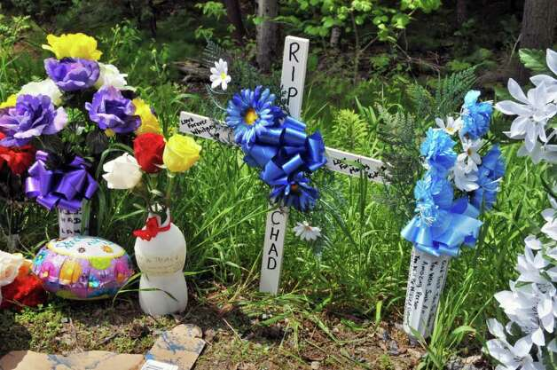 A roadside memorial on Tuesday afternoon, May 24, 2011, marks the scene where Chad Finch was fatally struck by a vehicle driven by an off-duty state trooper early Sunday morning along County Route 110 in Broadalbin.   (John Carl D'Annibale / Times Union) Photo: John Carl D'Annibale / 00013268A