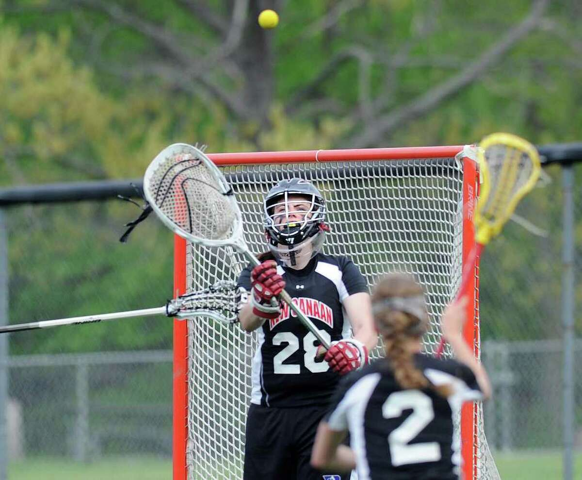 New Canaan High School goalie Elizabeth O'Sullivan was one of nine girls lacrosse players from six different schools whose eligibility was reinstated by the Connecticut Interscholastic Athletic Conference Tuesday morning, 24 hours after they were sanctioned for violating state rules.