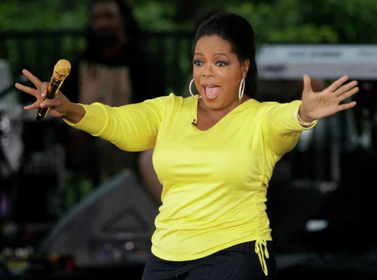FILE - This Sept. 8, 2009 file photo shows, Oprah Winfrey waves to her fans in Chicago while taping an episode of