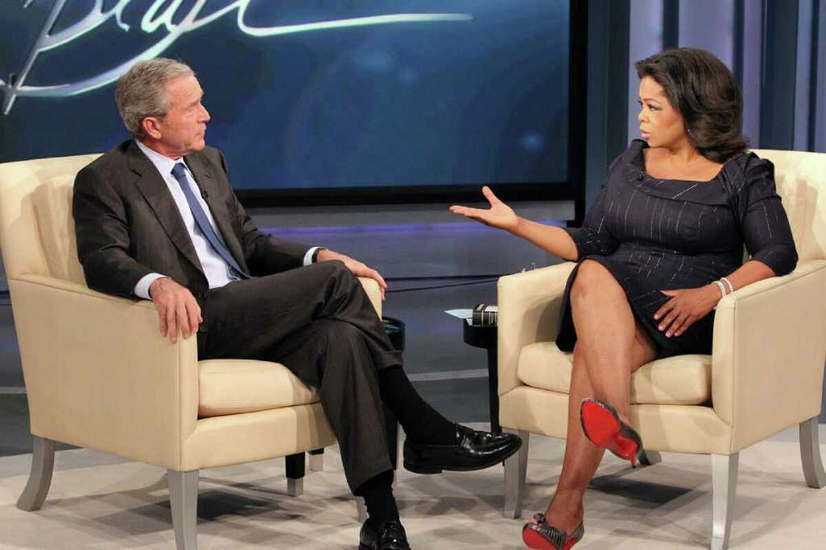 This photo taken Oct. 28, 2010 and provided by Harpo Productions Inc., shows talk-show host Oprah Winfrey interviewing former President George W. Bush during taping of