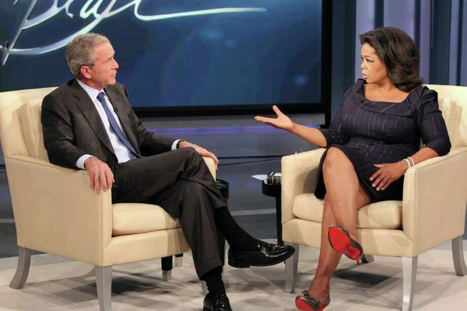"This photo taken Oct. 28, 2010 and provided by Harpo Productions Inc.,  shows talk-show host Oprah Winfrey interviewing former President George W. Bush during taping of ""The Oprah Winfrey Show"" at Harpo Studios in Chicago. The show will air nationally on Tuesday, Nov. 9, 2010. (AP Photo/Harpo Productions Inc., George Burns)  **NO SALES** Photo: George Burns, AP / Harpo, Inc./All Rights Reserved/George Burns."