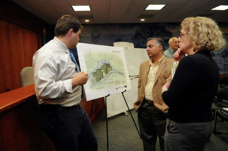 Domnick Celtruda, senior project manager of Diversified Technology Consultants, left, speaks about the plan to to upgrade Greenwich High School's music and auditorium space with John Conte, of Landscape Architects Conte & Conte and JoAnn Messina, executive director of Greenwich Tree Conservancy, at a hearing on the planned cutting down of 121 trees at the school to make way for the project on Tuesday, May 24, 2011. Photo: Helen Neafsey / Greenwich Time