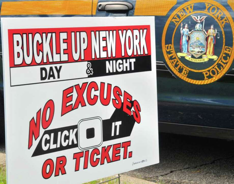 Click It or Ticket is a state initiative to encourage the use of seat belts. A news conference Tuesday with State Police and DMV officials called attention to the dangers of not buckling up.  (John Carl D'Annibale / Times Union) Photo: John Carl D'Annibale / 00013253A
