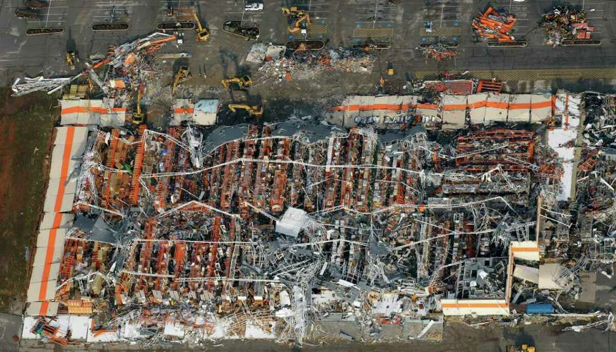 A destroyed Home Depot is seen in Joplin, Mo,. Tuesday. A large tornado moved through much of the city Sunday, damaging a hospital and hundreds of homes and businesses. AP Photo/Charlie Riedel)