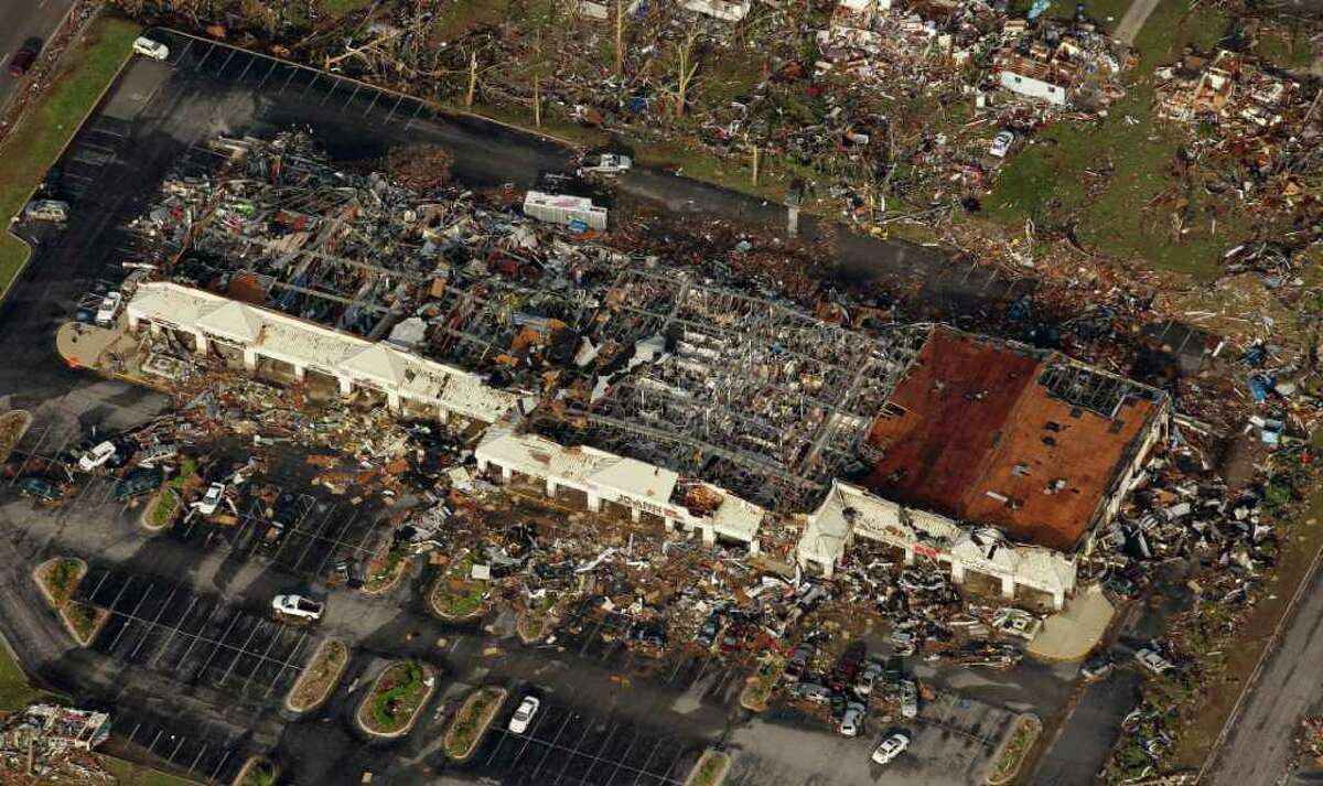 A destroyed shopping center is seen in Joplin, Mo. Tuesday.. A tornado moved through much of the city Sunday, damaging a hospital and hundreds of homes and businesses and killing at least 116 people.