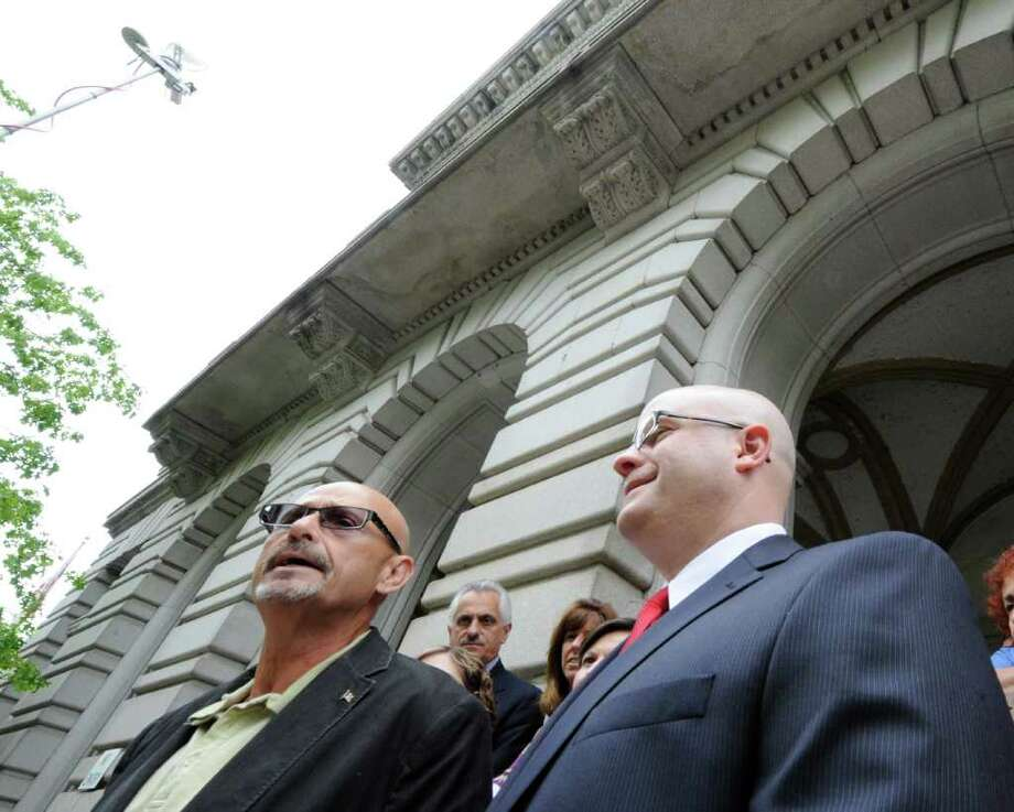 Career prosecutor Joel E. Abelove, right, stands with Rensselaer County GOP member Neil Kelleher as Abelove announces his candidacy for Rensselaer County District Attorney on the steps of the Rensselaer County Courthouse in Troy.  (Skip Dickstein/ Times Union) Photo: Skip Dickstein