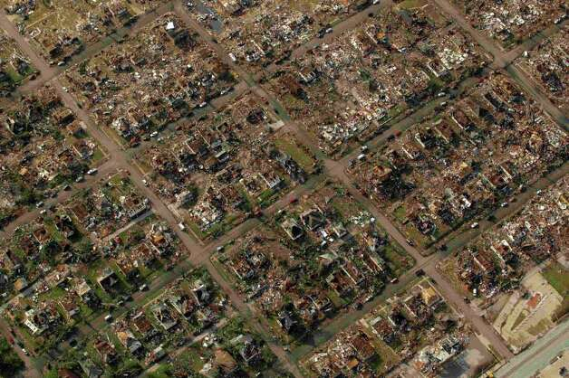 A neighborhood destroyed by a powerful tornado on Sunday is seen in Joplin, Mo. Tuesday, May 24, 2011. A tornado moved through much of the city Sunday, damaging a hospital and hundreds of homes and businesses and killing at least 116 people. (AP Photo/Charlie Riedel) Photo: Charlie Riedel, ASSOCIATED PRESS / ASSOCIATED PRESS