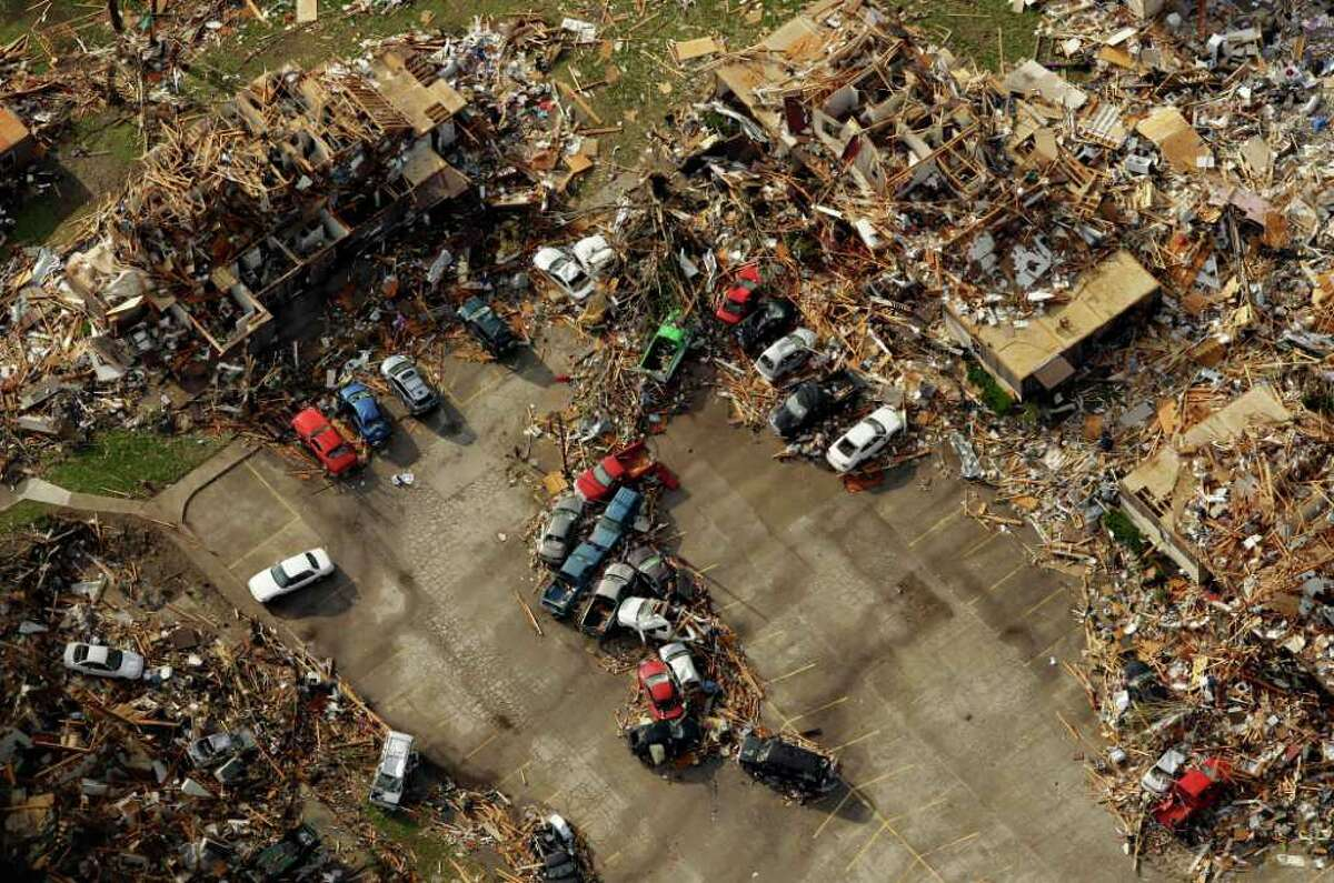 A destroyed apartment complex is seen in an aerial view over Joplin, Mo. Tuesday, May 24, 2011. A tornado moved through much of the city Sunday, damaging a hospital and hundreds of homes and businesses and killing at least 116 people. (AP Photo/Charlie Riedel)