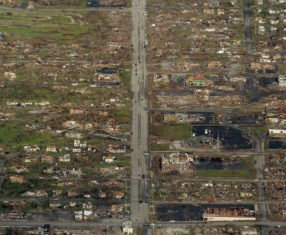 The path of a powerful tornado is seen in an aerial photo over Joplin, Mo., Tuesday, May 24, 2011. A tornado moved through much of the city Sunday, damaging a hospital and hundreds of homes and businesses and killing at least 116 people. (AP Photo/Charlie Riedel) Photo: Charlie Riedel, ASSOCIATED PRESS / ASSOCIATED PRESS