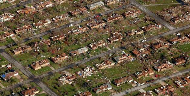 This aerial photograph shows a neighborhood destroyed by a powerful tornado in Joplin, Mo. Tuesday, May 24, 2011.  A tornado moved through much of the city Sunday, damaging a hospital and hundreds of homes and businesses and killing at least 116 people. (AP Photo/Charlie Riedel) Photo: Charlie Riedel, ASSOCIATED PRESS / ASSOCIATED PRESS