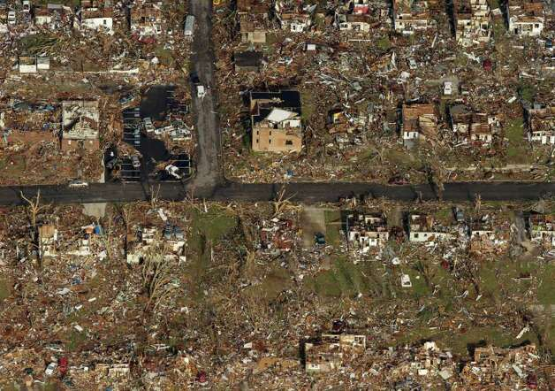 A neighborhood destroyed by a powerful tornado is seen in an aerial photo taken over Joplin, Mo., Tuesday, May 24, 2011. A tornado moved through much of the city Sunday, damaging a hospital and hundreds of homes and businesses and killing at least 116 people. (AP Photo/Charlie Riedel) Photo: Charlie Riedel, ASSOCIATED PRESS / ASSOCIATED PRESS