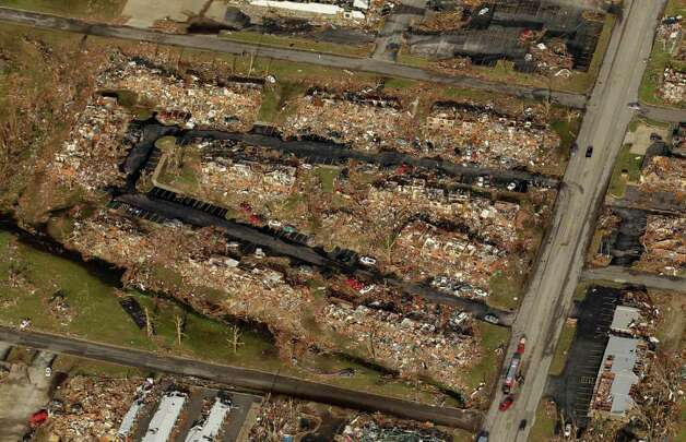 An apartment complex destroyed by a powerful tornado is seen in  an aerial view over Joplin, Mo. Tuesday, May 24, 2011. A tornado moved through much of the city Sunday, damaging a hospital and hundreds of homes and businesses and killing at least 116 people. (AP Photo/Charlie Riedel) Photo: Charlie Riedel, ASSOCIATED PRESS / ASSOCIATED PRESS