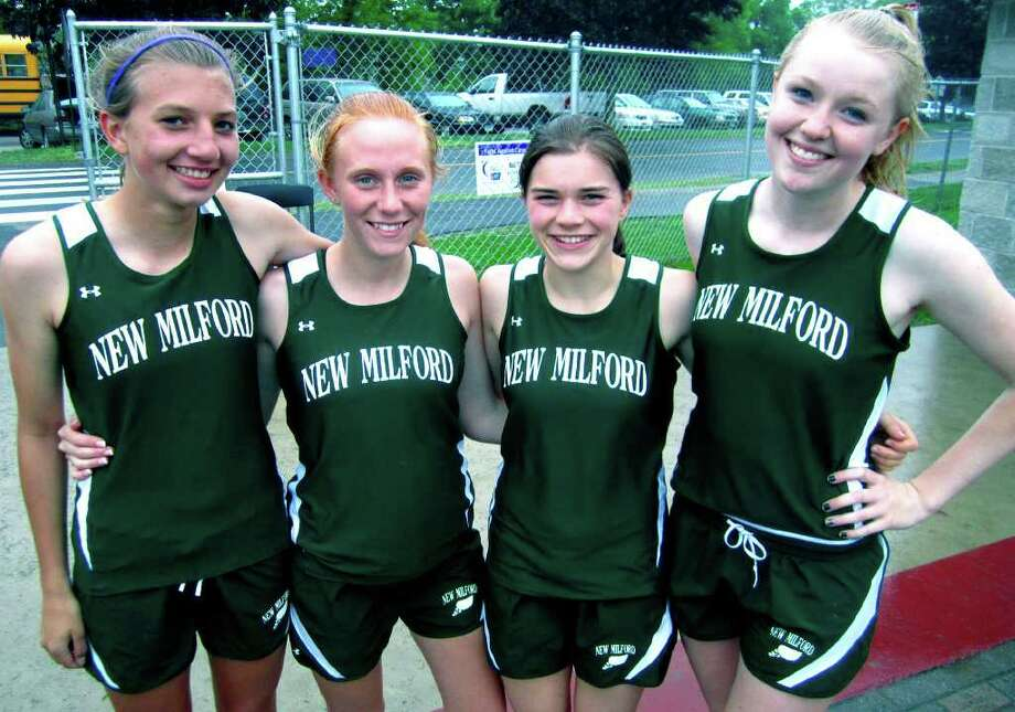 SPECTRUM/Celebrating their victory in the 4 x 800-meter relay at the May 23, 2011 South-West Conference meet at Bethel High School are, from left to right, New Milford High School girls' track teammates Sierra Grazia, Rachel Watson, Gabby Passarelli and Erin Kersten. The Green Wave quartet outclassed the field with a time of 9:45.6. Photo: Norm Cummings / The News-Times