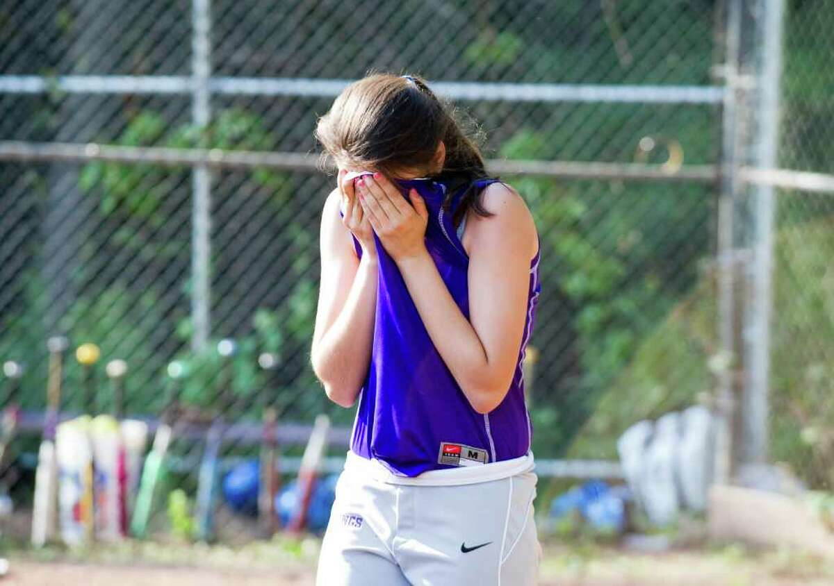 Westhill's Megan D'Alessandro reacts to the team's loss as Westhill hosts Fairfield Ludlowe High School in the girls softball FCIAC quarter finals in Stamford, Conn., May 24, 2011.