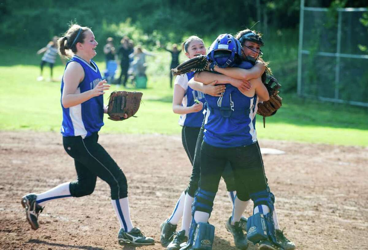 Fairfield Ludlowe player celebrate their win as Westhill hosts Fairfield Ludlowe High School in the girls softball FCIAC quarter finals in Stamford, Conn., May 24, 2011.