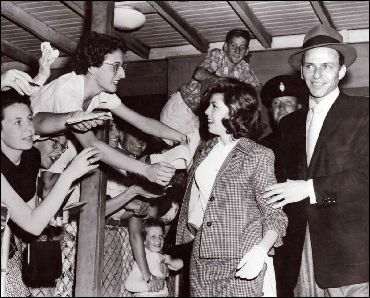Mobs of fans are nothing new, as Frank Sinatra and daughter Nancy, then 14, experienced when they arrived in Sydney, Australia on January 21, 1955.