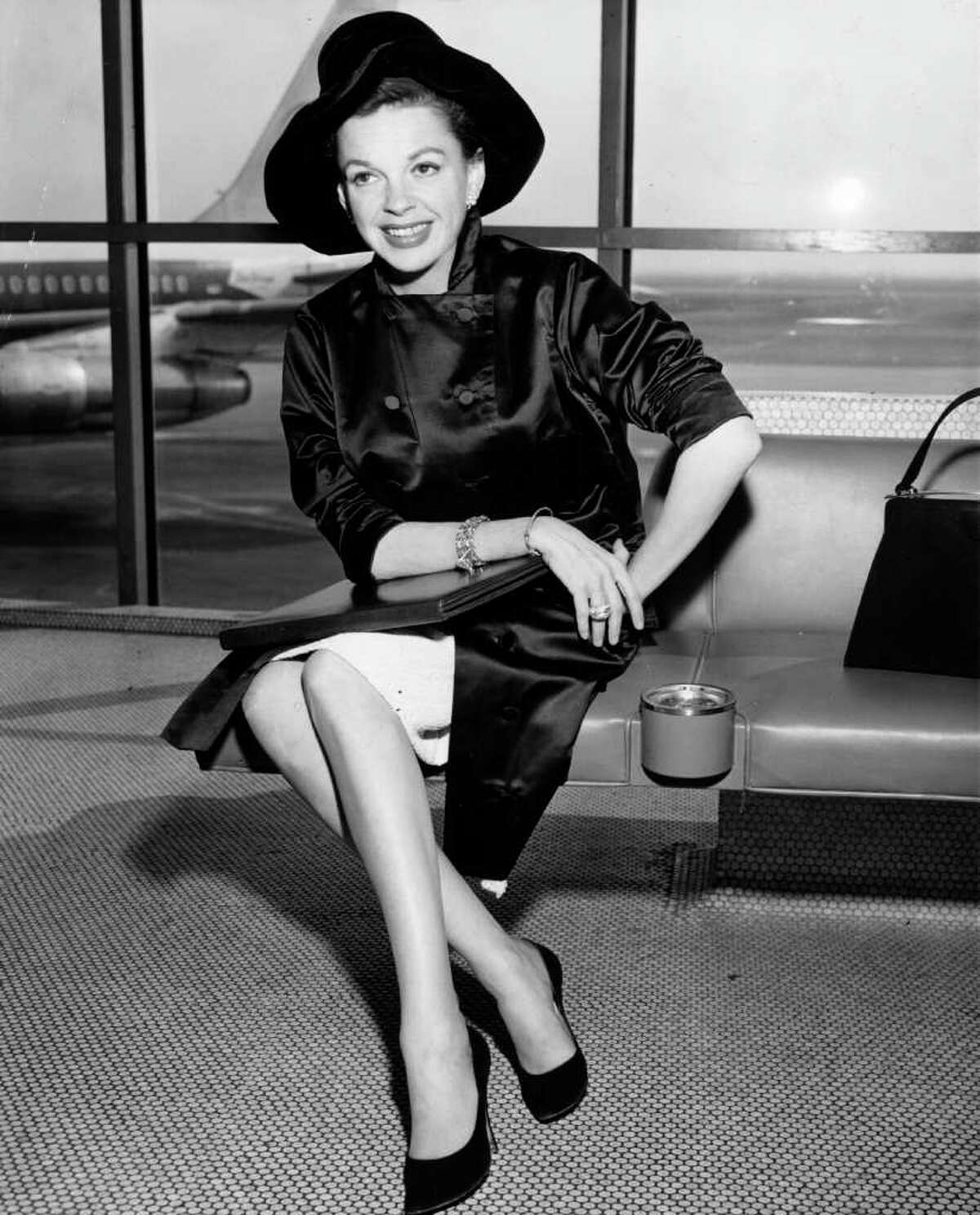 Here's singer and film star Judy Garland at an unidentified airport, circa 1955. Note the ashtray.