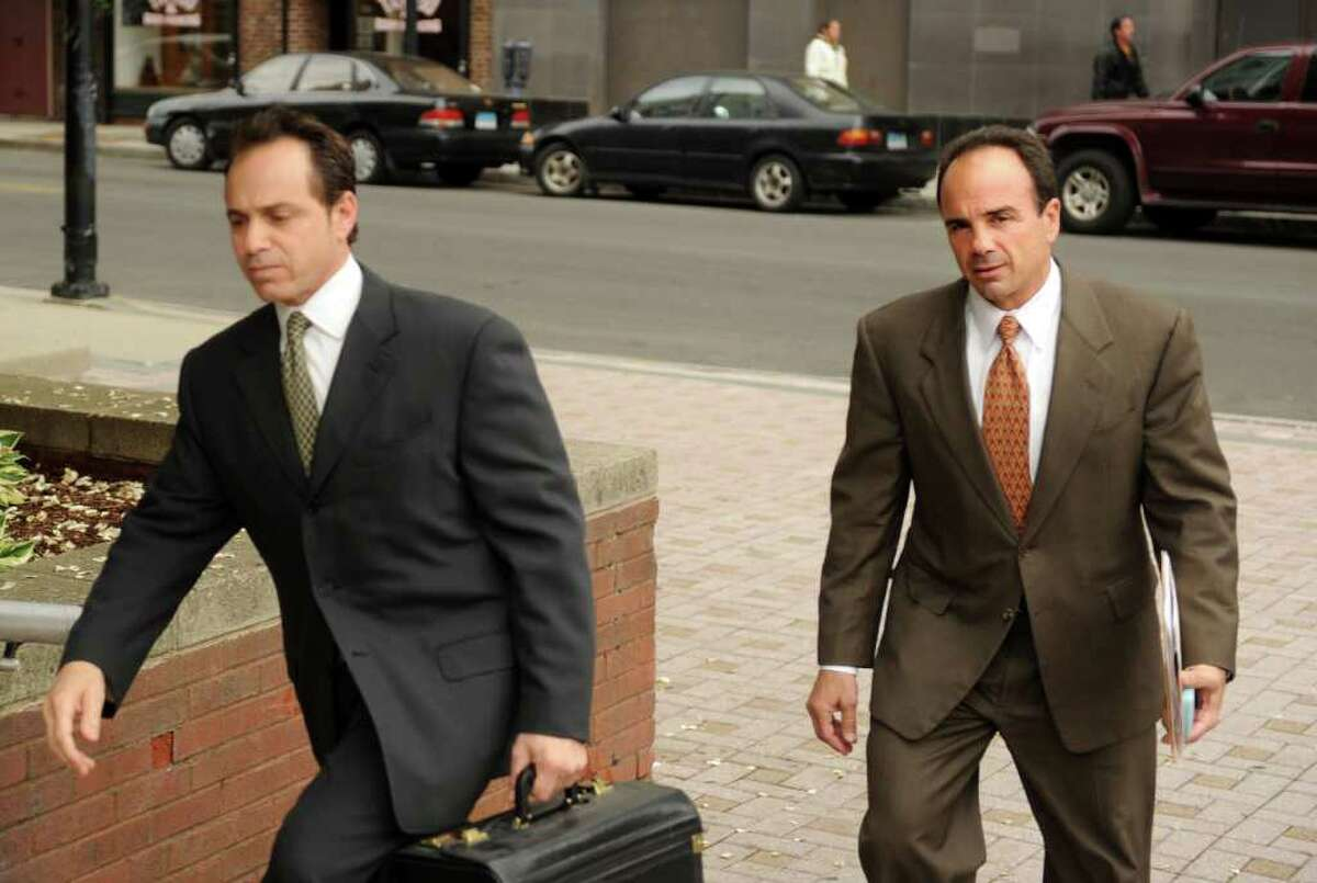 Former Bridgeport Mayor Joseph Ganim, right, with attorney George Ganim, Jr., enters Superior Court Tuesday, May 24, 2011 to attend a hearing to regain his law license.