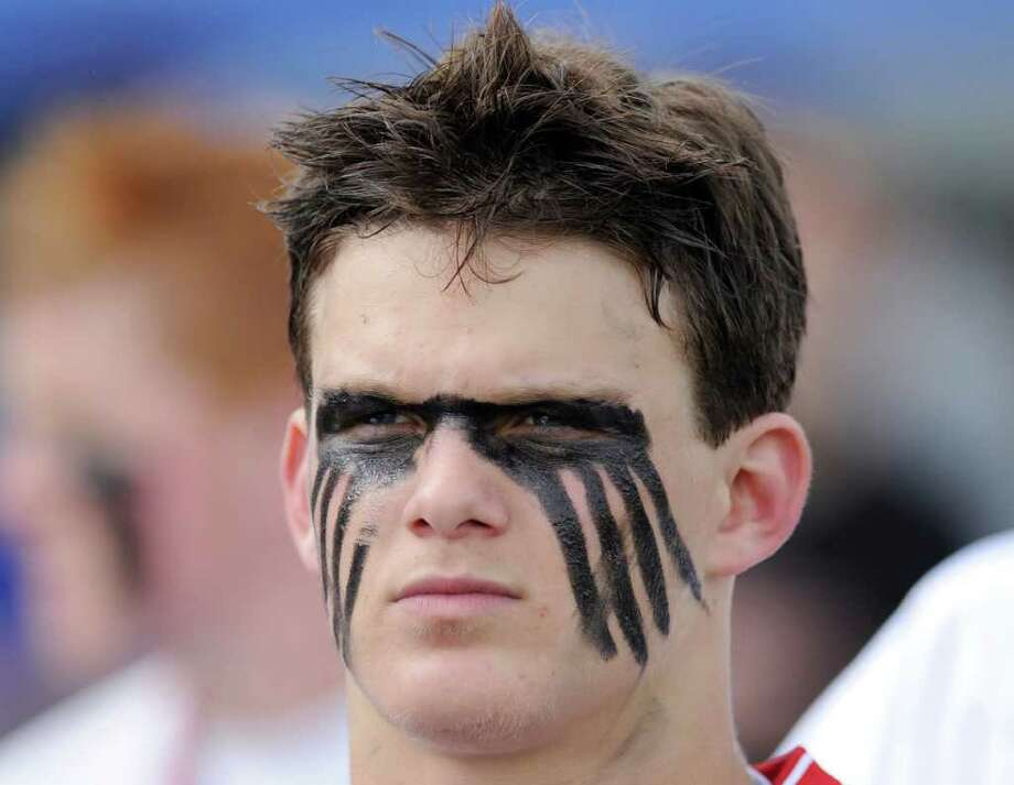 Alex Marcus, # 23 of Greenwich High School, with face painted at the start boys high school FCIAC lacrosse semifinal between Greenwich High School and Ridgefield High School at Brien McMahon High School, Norwalk, Tuesday night, May 24, 2011.  Ridgefield defeated Greenwich, 10-4. Photo: Bob Luckey / Greenwich Time