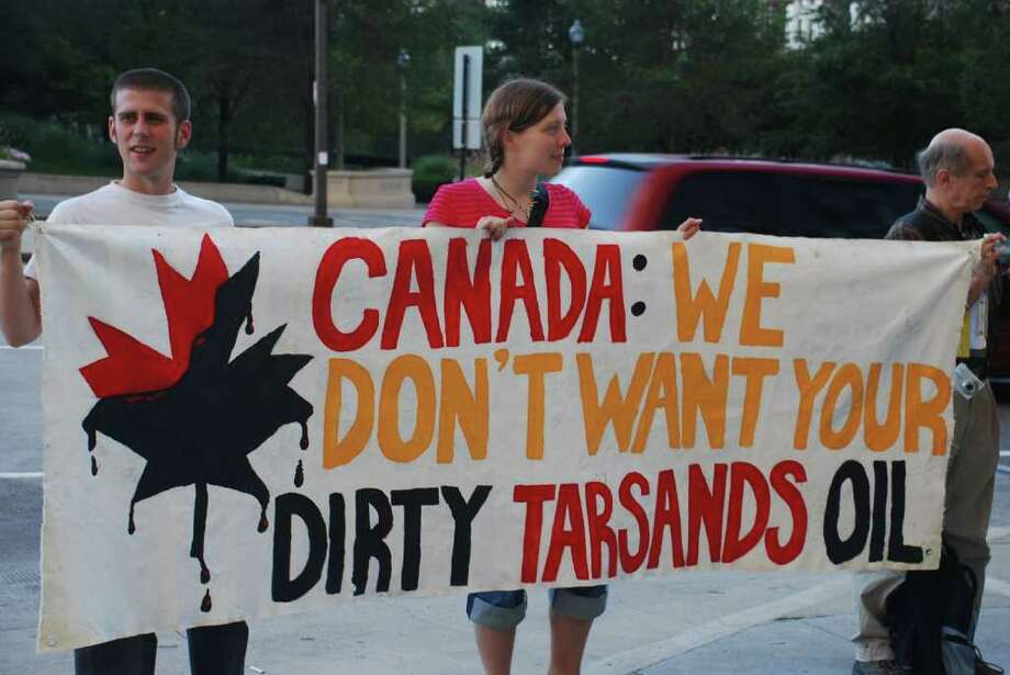 Plans call for the completion by 2013 of a 2,000-mile-long tar sands oil pipeline stretching from Canada to U.S. Gulf Coast refineries. It will carry as much as 900,000 barrels of oil per day, passing through six states and possibly jeopardizing the integrity of farmland, public water sources and wildlife habitat. Pictured: A Rainforest Action Network protest against the project in front of the Canadian Consulate in Chicago. Photo courtesy of the Rainforest Action Network. Photo: Contributed Photo / New Canaan News