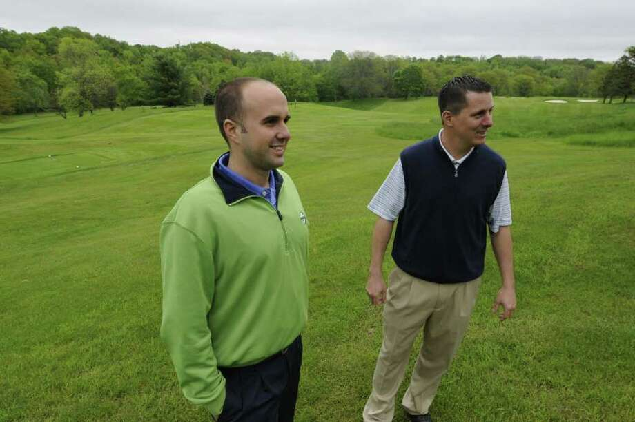 David Hostig, left, co-owner of Normanside Country Club, speaks with Normanside head golf pro, Erik Smith, right, on the club grounds in Delmar, Monday May 23, 2011. Photo: Will Waldron