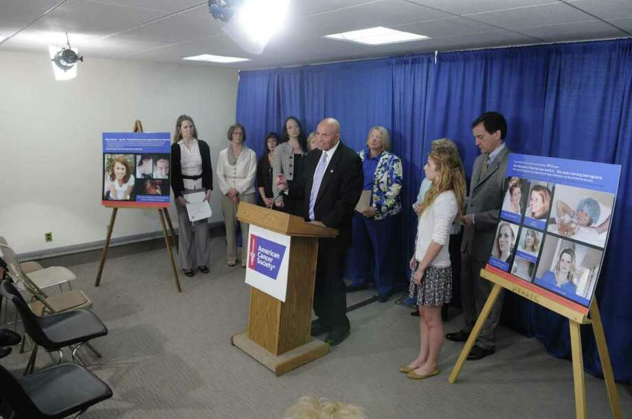 Assemblyman Harvey Weisenberg, at podium, addresses those gathered at a press conference held by legislators and organizations to promote legislation that would prohibit indoor tanning by children and teenagers under the age of 18.  The press event was  held on Tuesday afternoon, May 24, 2011 at the Legislative Office Building in Albany.  (Paul Buckowski / Times Union) Photo: Paul Buckowski  / 00013263A