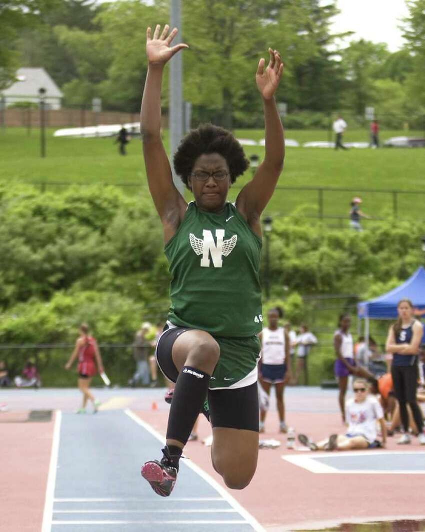 Norwalk's Leticia Lewis long jumps at the FCIAC Track and Field Championships Tuesday at Danbury High School.