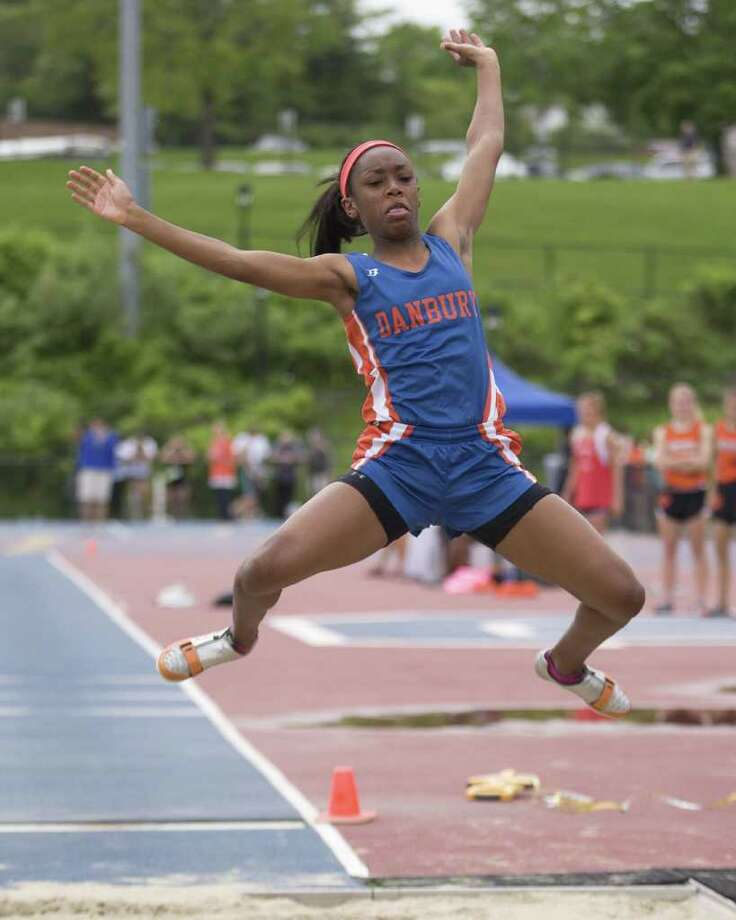 Danbury's Maya Walton wins the long jump at the FCIAC Track and Field Championships Tuesday at Danbury High School. Photo: Barry Horn