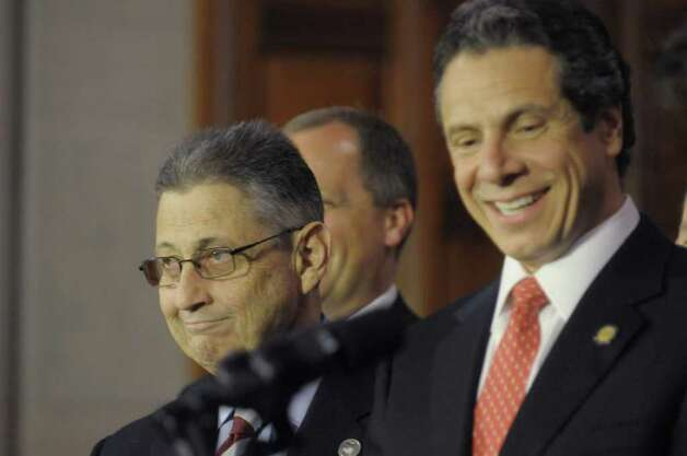 Assembly Speaker Sheldon Silver, left, and Governor Andrew Cuomo take part in a press conference at the Capitol on Tuesday afternoon, May 24, 2011 where the Governor and legislative leaders announced that a property tax cap would be passed by the end of session. (Paul Buckowski / Times Union) Photo: Paul Buckowski