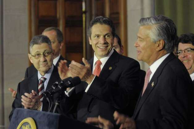 Assembly Speaker Sheldon Silver, left, Governor Andrew Cuomo, center, applaud as  Senate Majority Leader Dean Skelos, right, steps up to the podium to address those gathered at a press conference at the Capitol on Tuesday afternoon, May 24, 2011 where the Governor and legislative leaders announced that a property tax cap would be passed by the end of session. (Paul Buckowski / Times Union) Photo: Paul Buckowski