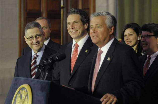 Assembly Speaker Sheldon Silver, left, Governor Andrew Cuomo, center, listen as  Senate Majority Leader Dean Skelos, right, address those gathered at a press conference at the Capitol on Tuesday afternoon, May 24, 2011 where the Governor and legislative leaders announced that a property tax cap would be passed by the end of session. (Paul Buckowski / Times Union) Photo: Paul Buckowski