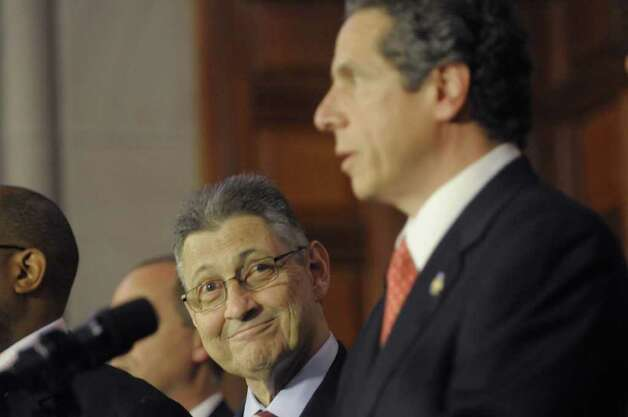 Assembly Speaker Sheldon Silver, left, smiles as Governor Andrew Cuomo speaks during a press conference at the Capitol on Tuesday afternoon, May 24, 2011 where the Governor and legislative leaders announced that a property tax cap would be passed by the end of session. (Paul Buckowski / Times Union) Photo: Paul Buckowski
