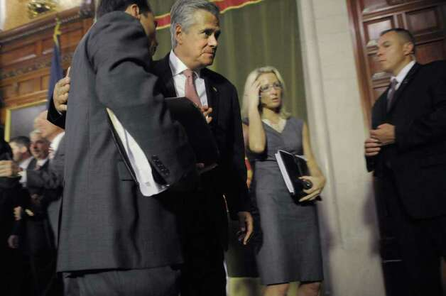 Senate Majority Leader Dean Skelos exits following a press conference at the Capitol on Tuesday afternoon, May 24, 2011 where the Governor and legislative leaders announced that a property tax cap would be passed by the end of session. (Paul Buckowski / Times Union) Photo: Paul Buckowski
