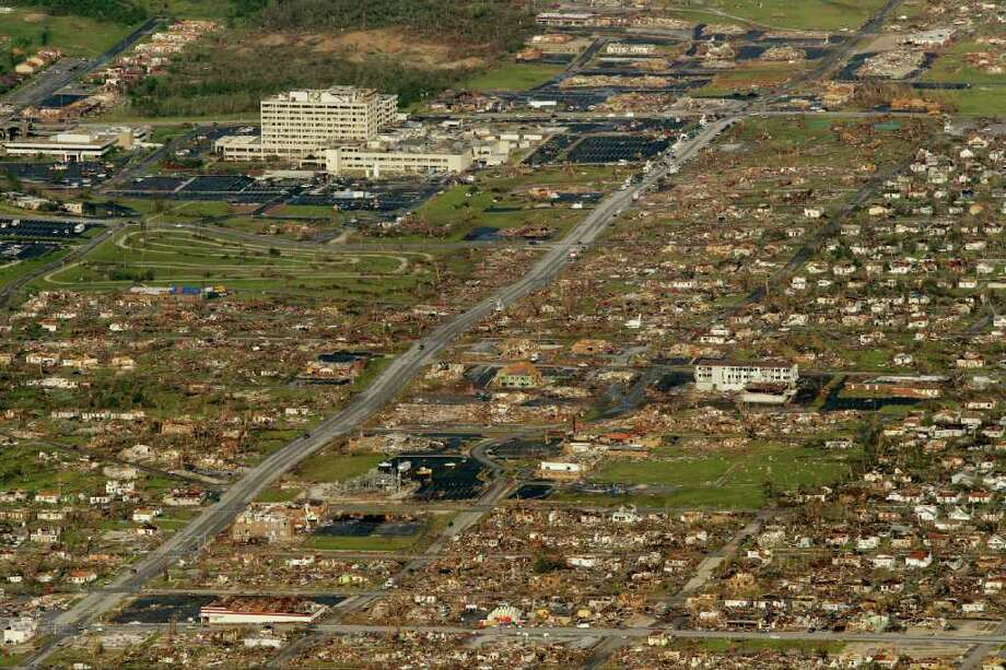 The path of a powerful tornado is seen in Joplin, Mo. Tuesday, May 24, 2011. A tornado moved through much of the city Sunday, damaging a hospital and hundreds of homes and businesses and killing at least 116 people. (AP Photo/Charlie Riedel) Photo: Charlie Riedel