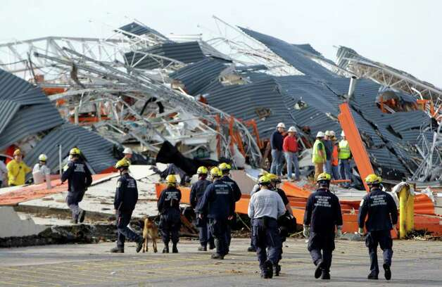Members of Missouri Task Force One search-and-rescue team work at a tornado-damaged Home Depot store Tuesday, May 24, 2011, in Joplin , Mo. A large tornado moved through much of the city Sunday, damaging a hospital and hundreds of homes and businesses. (AP Photo/Jeff Roberson) Photo: Jeff Roberson