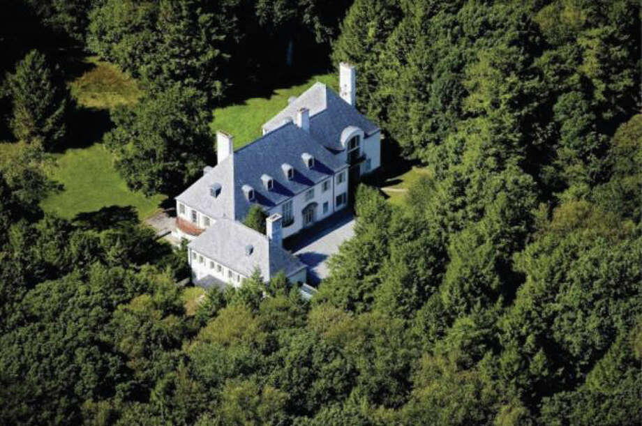 In 1952, Huguette Clark purchased Le Beau Chateau, a 22-room mansion that sits on 52 wooded acres at 104 Dans Highway in New Canaan. She never spent a night in the empty country home. MSNBC reported that Clark recently died at 104 years old. Lawyers filed a settlement Tuesday, Sept. 24, 2013, in the complex fight over Huguette Clark's estate. Photo: Contributed Photo / New Canaan News