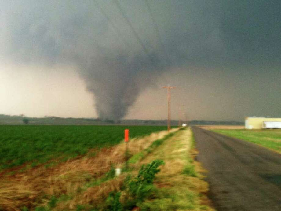 This photo provided by Shelby Barrow shows a tornado near Chickasha, Okla., on Tuesday. A line of violent thunderstorms roared across middle America on Tuesday, killing six people in two states, with several tornadoes touching down in Oklahoma and high winds pounding rural Kansas. (AP Photo/Shelby Barrow)  Photo: AP