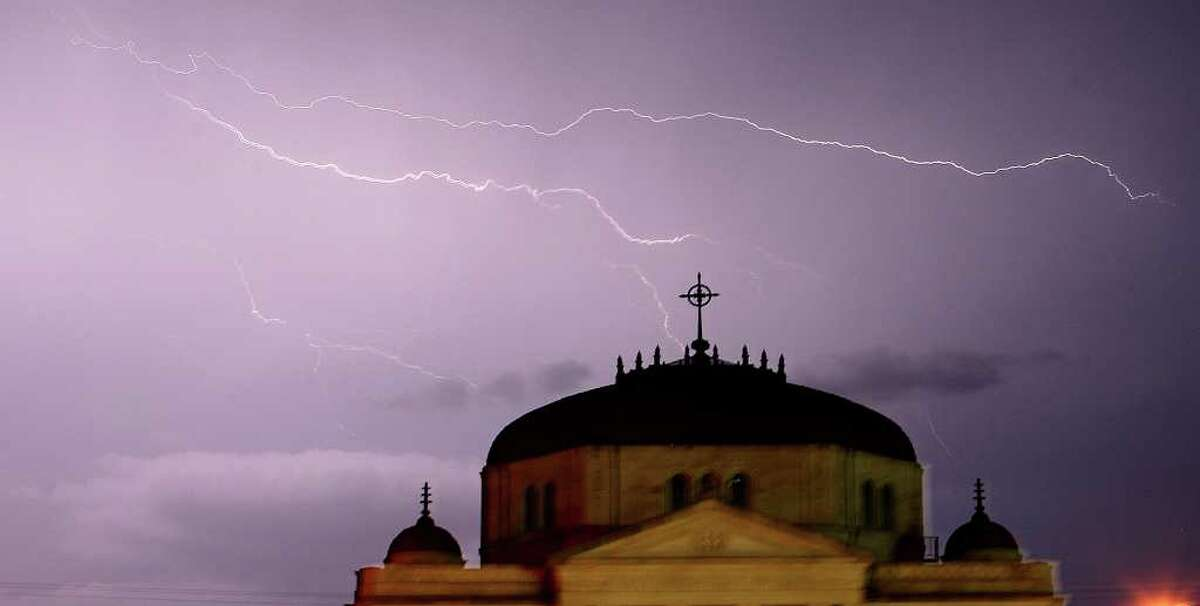 Lightning rips through the sky above the First Methodist Church in Paris, Texas, on Tuesday as more severe weather formed over northeast Texas.