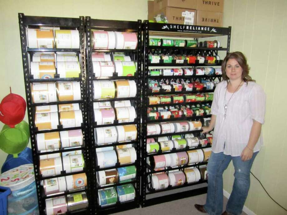 """Tiffany Ivanovsky, Woodlands mom, was on a recent episode of """"Extreme Couponing"""" on TLC. She and her husband saved about $1,000. Photo: Courtesy Of Discovery Press Web"""