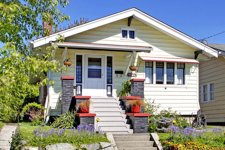 These days, you can find some nice houses in the greater Ballard area for around $350,000. Here are a few, starting with this one at 6526 4th Ave. N.W., listed for $359,950. The 1,600-square-foot house, built in 1907, has two bedrooms, a basement, brick fireplace, cool built-in cabinets and a bathroom remodeled with Travertine tile. Photo: Tucker English Photography/Windermere Real Estate
