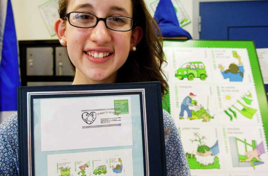"Trinity Catholic High School student Kelly Merole designed the ""Easy to Be Green"" special pictorial postmark that will be used as part of the ""Go Green Stamps"" campaign at the Camp Avenue US Post Office in Stamford, Conn. on Wednesday May 25, 2011. Photo: Kathleen O'Rourke / Stamford Advocate"
