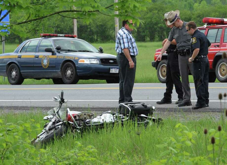 Guilderland and State Police investigate the scene of a serious motorcycle accident near the intersection of Dunnsville Road and Route 20 in Guilderland. A Fultonville man was taken to Albany Medical Center.   (Skip Dickstein / Times Union) Photo: SKIP DICKSTEIN / 2008