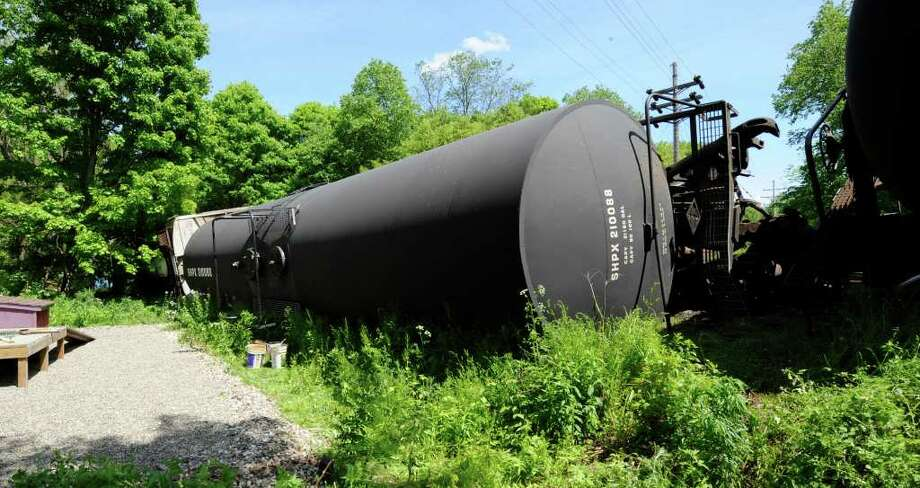 A fertilizer tanker on its side in Eagle Bridge, N.Y., after a train derailment on May 25, 2011.  (Skip Dickstein / Times Union) Photo: SKIP DICKSTEIN