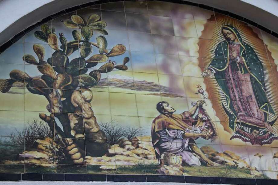 A mural adorns the front doorway at Our Lady of Guadalupe Church. Photo: Photo By Noi Mahoney