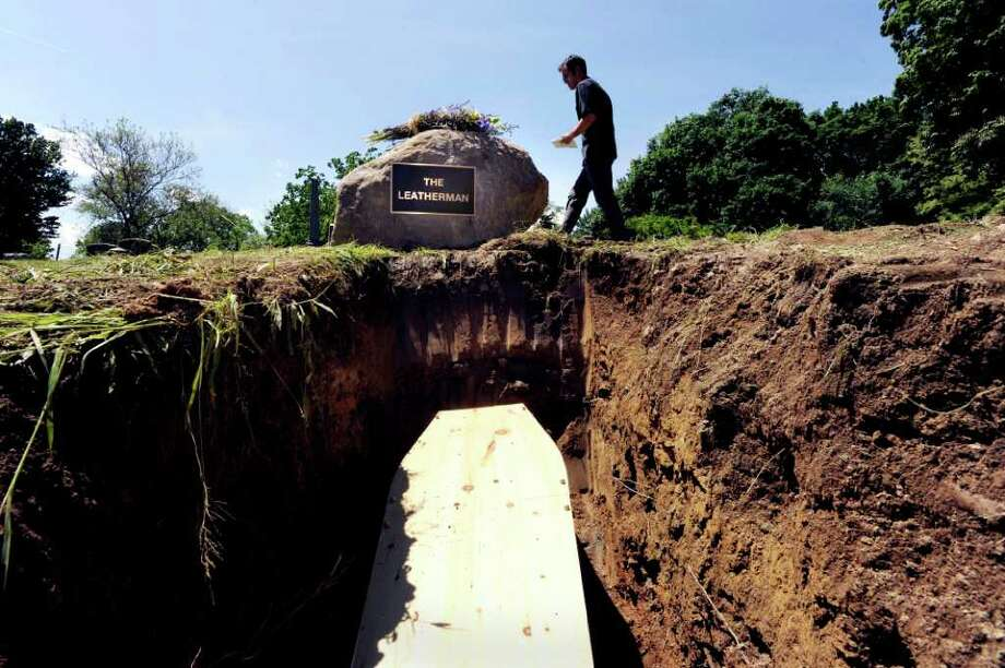 """A newly buried casket holds soil and nails found in the former grave of 'the Leather Man"""", a leather-clad wanderer who walked throughout western Connecticut and lower New York during the late 1800s, in Sparta Cemetery, Ossining, N.Y., Wednesday afternoon, May 25, 2011.  The contents of the former grave of the historical figure were transferred to a new location Wednesday. Photo: Bob Luckey / Greenwich Time"""