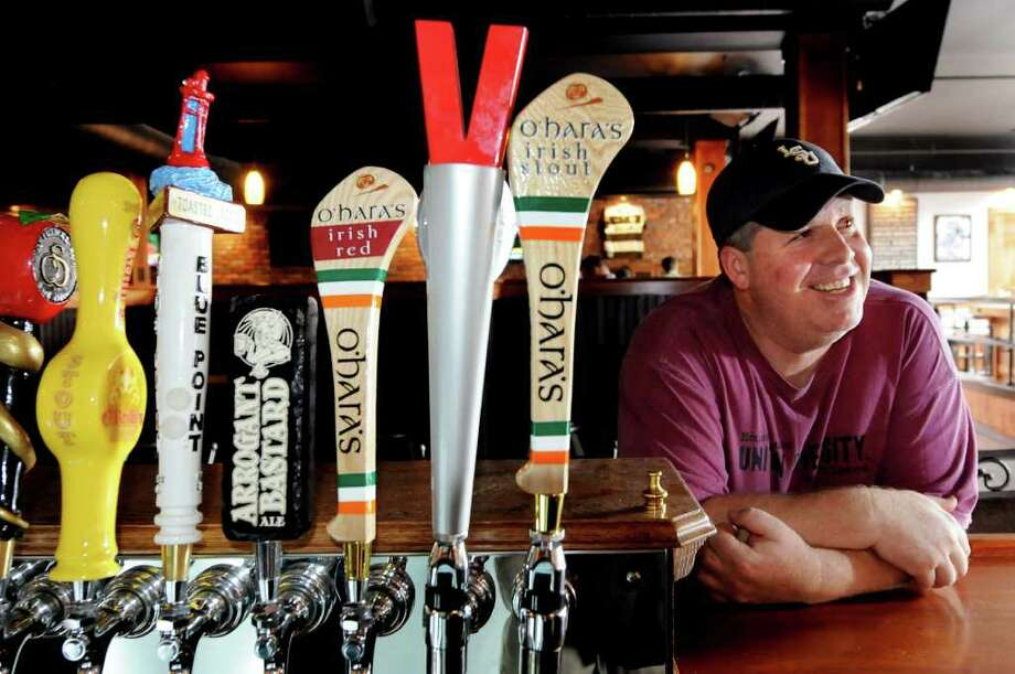Mike Graney stands at the bar by the beer taps at his new tavern called Stout on Tuesday, May 24, 2011, in Albany, N.Y. (Cindy Schultz / Times Union) Photo: Cindy Schultz