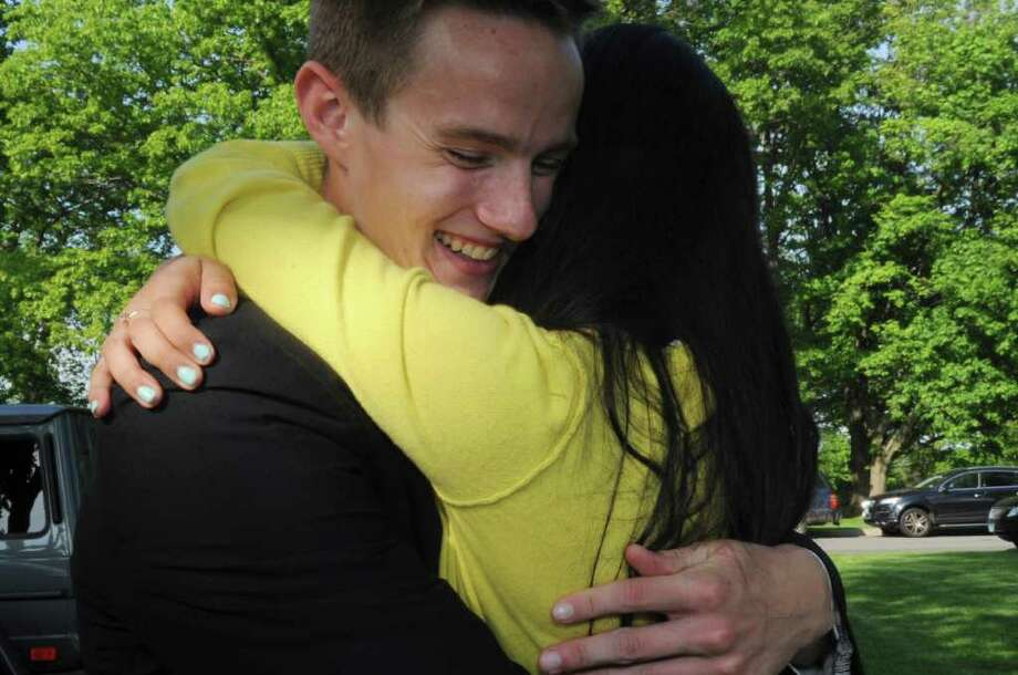 Brunswick graduated senior Ryan William Gartin and friend Melody Pabon share a hug at the reception after the Brunswick School's 109th commencement on Wednesday, May 25, 2011. Photo: Helen Neafsey / Greenwich Time