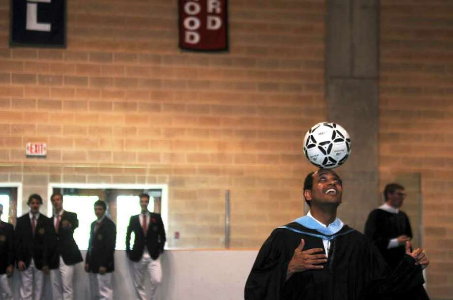 Brunswick School Arabic teacher Ali Almaqtari balances a soccer ball on his head before the school's commencement ceremony on Wednesday, May 25, 2011. Photo: Helen Neafsey / Greenwich Time