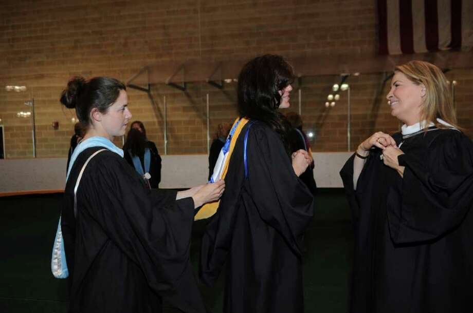 Brunswick teachers Vanessa Moors, left, Kim Goodman and Alina Hoyos get ready for the school's graduation ceremony on Wednesday, May 25, 2011. Photo: Helen Neafsey / Greenwich Time